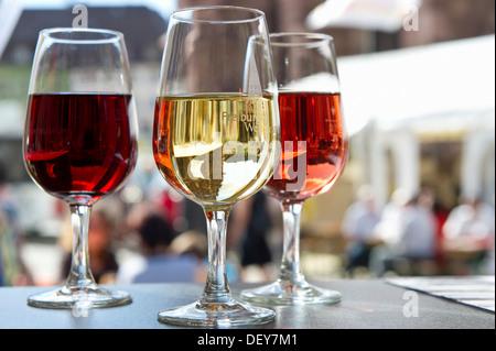 Glasses with red, white and rosé wine, wine festival, Freiburg im Breisgau, Black Forest, Baden-Wuerttemberg - Stock Photo