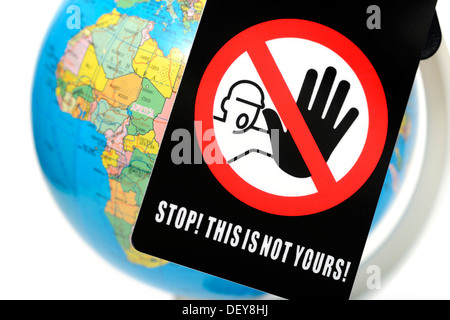 Globe with sign Stop, this is yours!, Globus mit Schild Stop, this is not yours! - Stock Photo