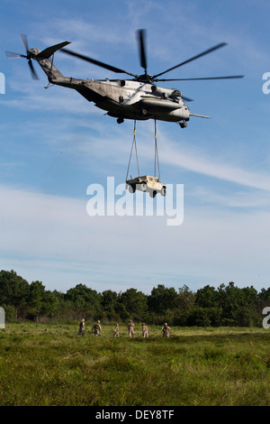 U.S. Marines from Marine Heavy Helicopter Squadron 464, use a Scikorsky CH-53E Super Stallion to externally lift a High Mobility Multipurpose Wheeled Vehicle at Camp LeJeune, North Carolina on September 12, 2013. The HST was part of an annual training eve