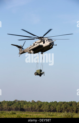 U.S. Marines from Marine Heavy Helicopter Squadron 464, externally lift a generator with a Scikorsky CH-53E Super Stallion at Camp LeJeune, North Carolina on September 12, 2013. The HST was part of an annual training event to maintain mission readiness.