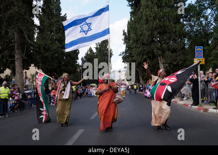 Christians from Kenya carrying the Israeli flag as they take part in the annual Jerusalem March during Sukkot feast - Stock Photo