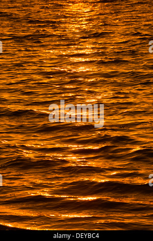 Reflections on the water surface at sunset, Sanibel Island, Florida, United States - Stock Photo