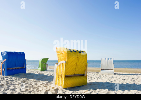 Coloruful beach chairs on the beach near Wyk, Foehr Island, North Frisian Islands, Schleswig-Holstein - Stock Photo
