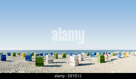 Panoramic image, colourful roofed wicker beach chairs on the beach near Wyk, Foehr Island, North Frisian Islands - Stock Photo