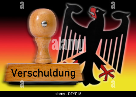 Stamp with the word 'Verschuldung', debt, German eagle and national colors - Stock Photo