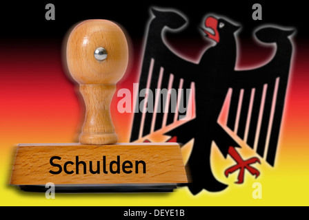 Stamp with the word 'Schulden', debt, German eagle and national colors - Stock Photo