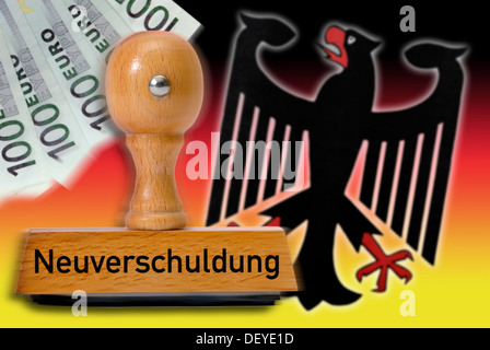 Stamp with the word 'Neuverschuldung', new indebtedness, German eagle and national colors - Stock Photo
