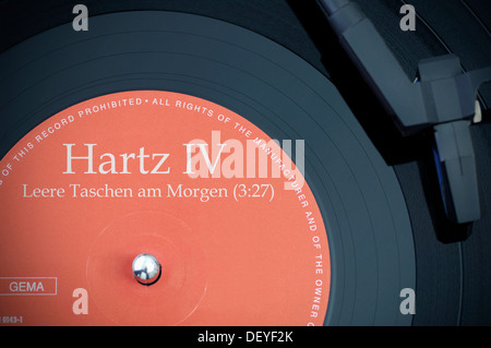 Record labeled 'Hartz IV' and 'Leere Taschen am Morgen', empty pockets on the morning - Stock Photo