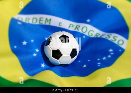 Football on Brazilian flag, football world championship in 2014 in Brazil, - Stock Photo