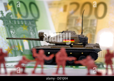 Miniature tanks with Germany flag in front of banknotes, symbolic image for German arms exports - Stock Photo