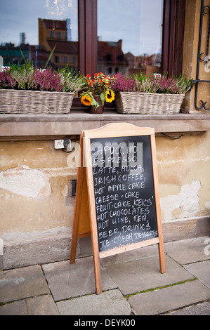 menu on blackboard in front of coffeehouse - Stock Photo
