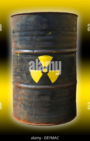 Rusty barrel with a radiation warning symbol - Stock Photo