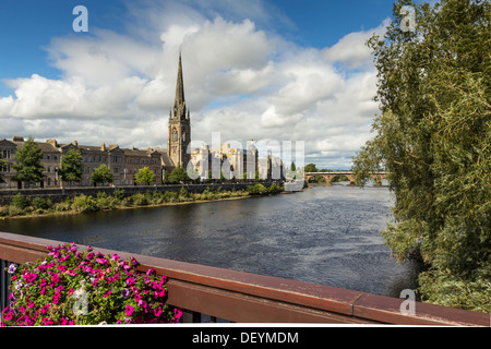 PERTH CITY SCOTLAND FLOWERS ON THE ROAD BRIDGE AND THE OLD BRIDGE OVER THE RIVER TAY BEYOND - Stock Photo