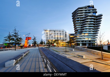 Marco-Polo-Tower and the Unilever headquarters on the Strandkai quay in the Hafencity district in Hamburg - Stock Photo