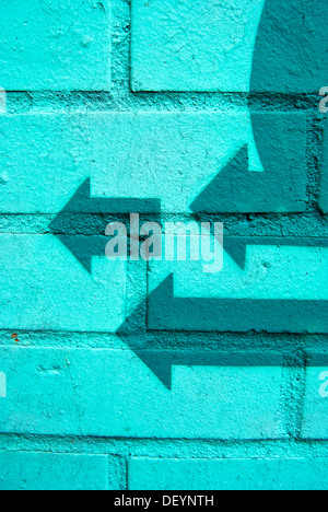 Three green arrows point in the same direction, graffiti - Stock Photo