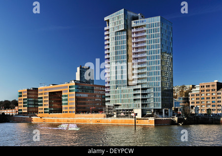 Holzhafen West office complex and Kristall residential tower on Grossen Elbstrasse, Oevelgoenne, Altona, Hamburg - Stock Photo