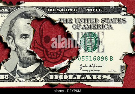Burnt five-dollar bill, symbolic image for the national debt of the USA - Stock Photo