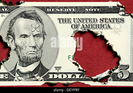 Burnt five dollar bill, symbolic image for US national debt - Stock Photo