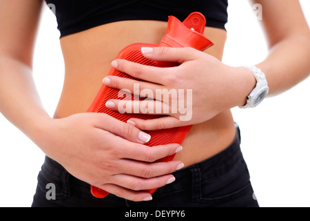 Woman with hot-water bottle, Frau mit Wärmflasche - Stock Photo