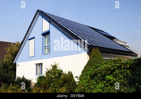 House with solar panels on the roof - Stock Photo
