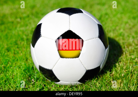 Black-and-white football with Germany flag, Schwarz-weißer Fußball mit Deutschlandfahne - Stock Photo
