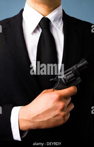 Business man holding a gun - Stock Photo