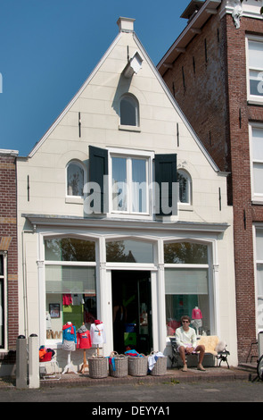 Harlingenfashion shop for children Friesland Netherlands - Stock Photo