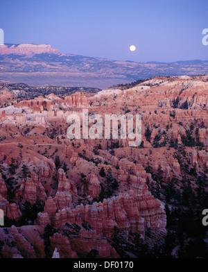 Moonrise over ´hoodoos´ (evening twilight October). Bryce Canyon National Park. Utah. USA - Stock Photo