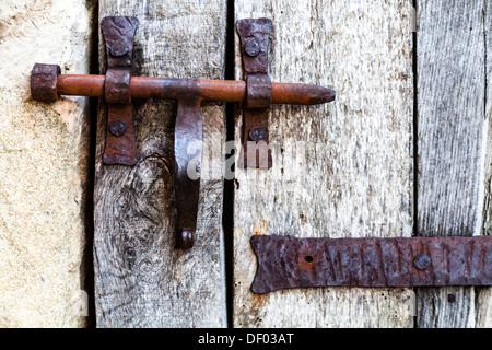 Old door lock in Belves, Aquitaine, France, Europe - Stock Photo
