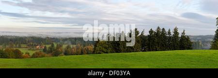 Autumn morning mist over the Loisach Valley near Bad Heilbrunn, Upper Bavaria - Stock Photo