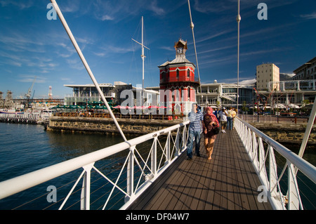 People crossing a swing bridge, Nelson Mandela Gateway, Clock Tower, Victoria & Alfred Waterfront, Cape Town, Western - Stock Photo