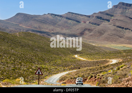 Car travelling on the road, warning sing for gravel road, Cederberg mountains, Western Cape, South Africa, Africa - Stock Photo