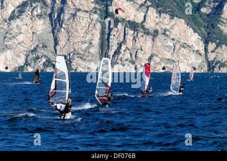 Wind surfers surfing in strong winds on Lake Garda in Malcesine, Veneto, Italy, Europe - Stock Photo