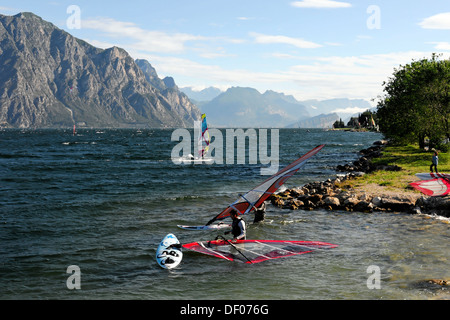 Wind surfer surfing in strong winds on Lake Garda in Malcesine, Veneto, Italy, Europe - Stock Photo