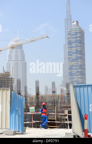 A worker on construction site in Dubai down town - Stock Photo