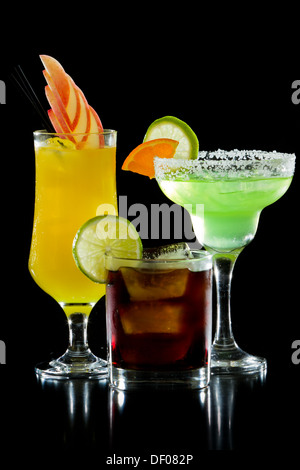 three colorful refreshing cocktails served on a black background - Stock Photo