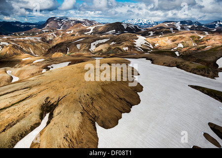 Aerial view, rhyolite mountains partially covered with snow, Landmannalaugar, Fjallabak conservation area, Icelandic - Stock Photo
