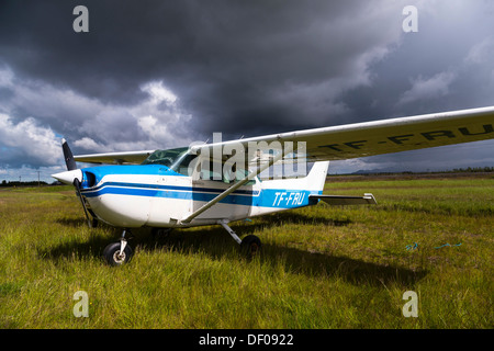 Cessna airplane on a meadow, Suðurland, South Iceland, Iceland, Europe - Stock Photo