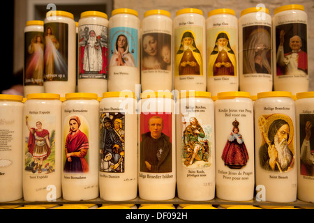 candles with saints images inside The Onze-Lieve-Vrouwekathedraal (Cathedral of our Lady) in Antwerp, Belgium, Europe - Stock Photo