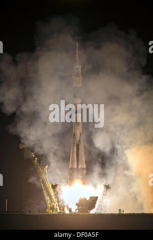 International Space Station Expedition 37 flight crew lift off on the Soyuz TMA-10M rocket launch at the Baikonur - Stock Photo