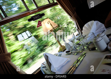 Laid table in a restaurant car, historic English train - Stock Photo