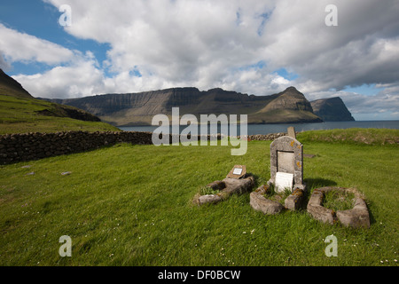 Old graves in a small cemetery near the sea, Vidareidi, Viðareiði, Faroe Islands, Denmark, Northern Europe, Europe - Stock Photo