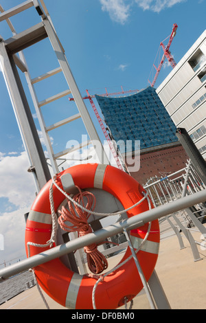Elbe Philharmonic Hall in HafenCity, slanted image with a life ring, Hamburg, northern Germany, Europe - Stock Photo