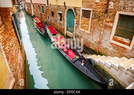 Gondolas on canal in Venice - Stock Photo