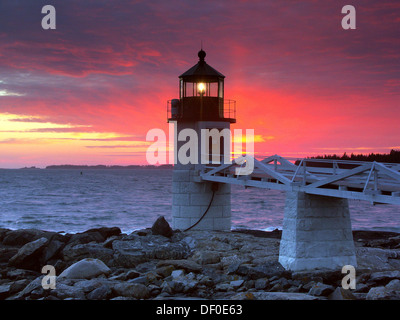 Spectacular sunset behind Marshall Point Lighthouse in Port Clyde, Maine, USA - Stock Photo