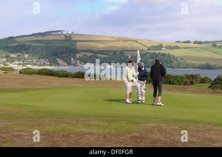 Women playing a round of golf at Chanonry Point on the Black Isle, UK - Stock Photo