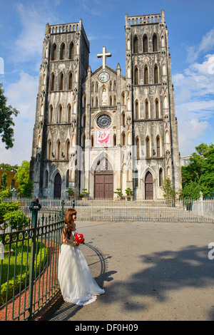 bride to be in front of St. Joseph's Cathedral in Hanoi, Vietnam - Stock Photo