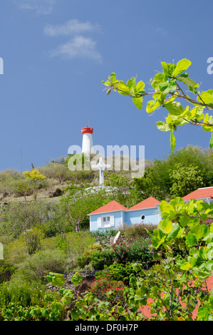 French West Indies, Caribbean island of Saint Barthelemy (St. Bart's), capital city of Gustavia. Island lighthouse - Stock Photo