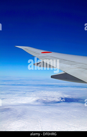 Sky and clouds a view from All Nippon Airways Boeing 777 - Stock Photo