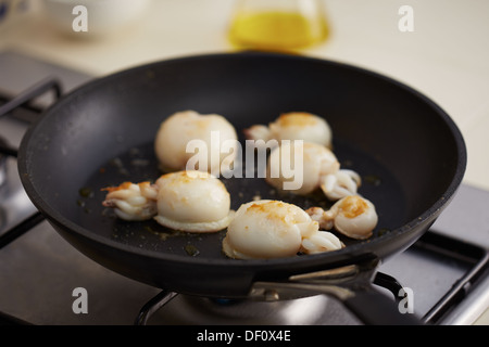 Preparing grilled cuttlefish in a pan close-up - Stock Photo